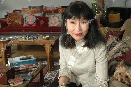 Amy Tan Author Amy Tan poses in her apartment in New York's Soho section, with her dog, Bubba