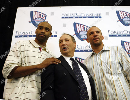 Vince Carter, Jason Kidd, Bruce Ratner New Jersey Nets' Vince Carter, left, and Jason Kidd, right, pose for a picture with developer Bruce Ratner, center, during a news conference in Brooklyn, New York. The press conference brought together supporters of Ratner's Atlantic Yards project, which would create a new stadium for the New Jersey Nets in Brooklyn, in addition to mixed-income housing and commercial and retail space