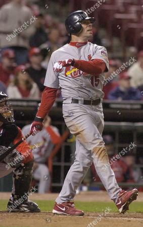 EDMONDS LARUE St.Louis Cardinals' Jim Edmonds (15) hits a three-run home run off Cincinnati Reds' Danny Graves during the ninth inning, in Cincinnati. Reds catcher Jason LaRue watches at left. The Cardinals won, 10-9