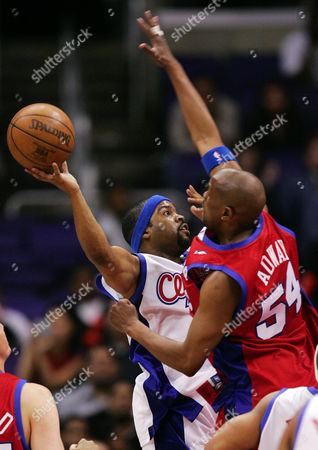 ADWAY ICE CUBE Rapper and actor Ice Cube puts up a shot as actor Dwayne Adway guards during celebrity game, in Los Angeles