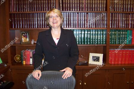New Minnesota Supreme Court Chief Justice Lorie Skjerven Gildea poses for a photo in her office in St. Paul Minn., . Minnesota's new chief justice, Lorie Skjerven Gildea, said Tuesday her top priority will be securing enough money for a court system that's slowing down due to budget cuts that have left the courts short-staffed