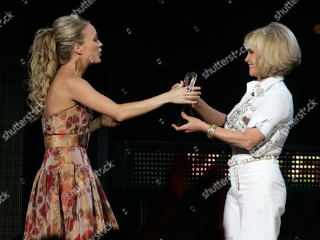 Carrie Underwood, Barbara Mandrell Carrie Underwood, left, is presented the video of the year award by Barbara Mandrell at the CMT Music Awards in Nashville, Tenn