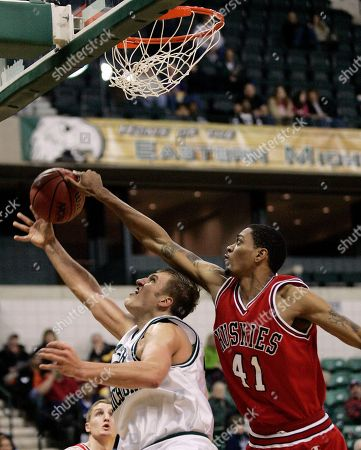 Eastern Michigan forward John Bowler, left, has his layup blocked by Northern Illinois center James Hughes during the first half of their Mid-American Conference college basketball game, in Ypsilanti, Mich