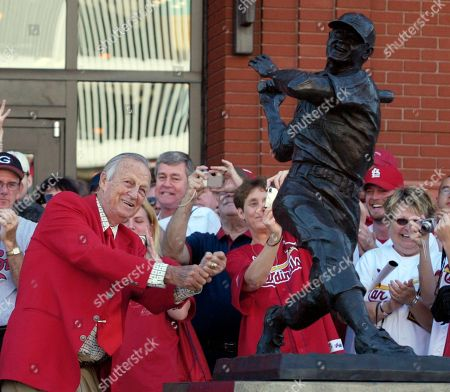 """Stan Musial St. Louis Cardinals great Stan """"The Man"""" Musial strikes his signature pose after unveiling his statue at the re-dedication ceremony for the statues, at the new Busch Stadium, of Cardinals Hall-of- Famers and notables before a baseball game against the Milwaulkee Brewers in St. Louis. Musial, one of baseball's greatest hitters and a Hall of Famer with the St. Louis Cardinals for more than two decades, died, the Cardinals announced. He was 92"""