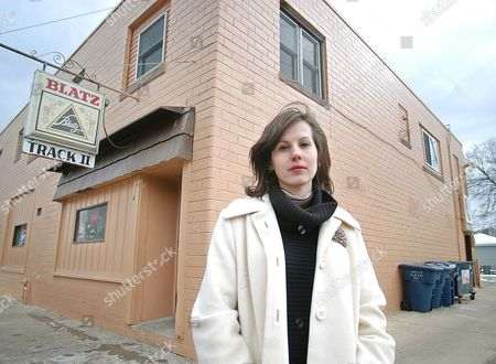 """Stock Picture of Author Danielle Trussoni stands before one of the bars that figures in her memoir """"Falling Through the Earth,"""" in La Crosse, Wis., on . Trussoni is one of new memoirists whose work may fall under suspicion following revelations that significant parts of James Frey's memoir, """"A Million Little Pieces,"""" were fabricated"""