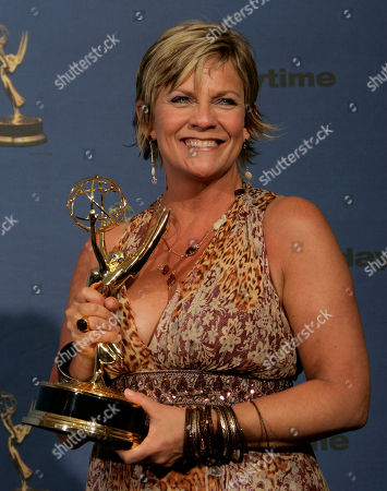 """Kim Zimmer Kim Zimmer holds the award for outstanding lead actress in a drama series, for her work on """"Guiding Light,"""" backstage at the 33rd Annual Daytime Emmy Awards in Los Angeles on"""