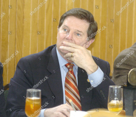 U.S. Rep. Tom DeLay, R-Texas, listens to keynote speaker, Jeff Cohen, editor of the Hopuston Chronicle at the U.S. Chamber of Commerce Luncheon in League City, Texas