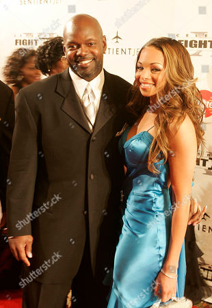 SMITH Emmitt Smith, left, and his wife Patricia Southall-Lawrence Smith walk the red carpet at the Arizona Biltmore during Celebrity Fight Night XI in Phoenix