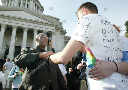 Stock Photo of DRAKE OLSON The Rev. Harvey Drake, left, of the Emerald City Bible Fellowship, who opposes gay marriage, talks with Ryan Olson, right, a Gonzaga University student, who supports gay marriage, before a rally at the state Capitol in Olympia, Wash., . The Washington state Supreme Court is heard arguments Tuesday in a gay marriage case. It's being asked to decide if the state Defense of Marriage Act is unconstitutional