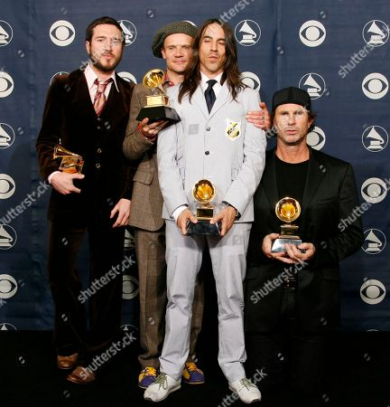 John Frusciantea, Flea, Anthony Kiedis, Chad Smith The Red Hot Chili Peppers from left, John Frusciantea, Flea, Anthony Kiedis and Chad Smith pose with their awards for best rock song, best rock album and best rock performance at the 49th Annual Grammy Awards, in Los Angeles