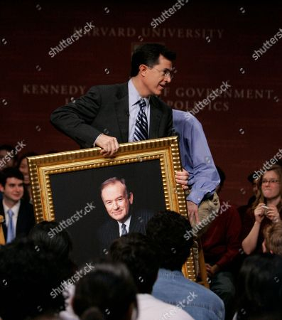 Steven Colbert, Bill O'Reilly Comedian Steven Colbert carries a portrait of radio talk show host Bill O'Reilly while addressing a gathering at Harvard University's John F. Kennedy School of Government in Cambridge, Mass