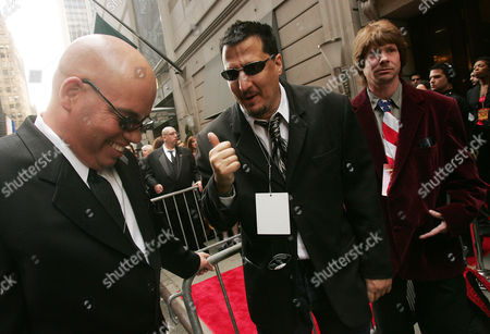 "Sam Simon, center, writer and developer of ""The Simpsons,"" talks to an unidentified man as he arrives for Howard Stern 2006 Film Festival outside Hudson Theatre in New York"
