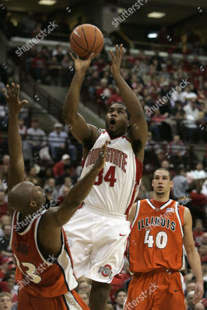 DIALS MCBRIDE Ohio State center Terrence Dials (34) shoots against Illinois guard Rich McBride (33) in the second half of an NCAA basketball game in Columbus, Ohio