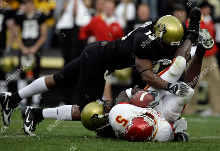 Terry Washingotn, R J Sumrall, Joe Sanders Colorado defenders Joe Sanders, left, and Terry Washington, back right, pull down Iowa State's R.J. Sumrall in the fourth quarter of Colorado's 33-16 victory in a Big-12 football game in Boulder, Colo., on