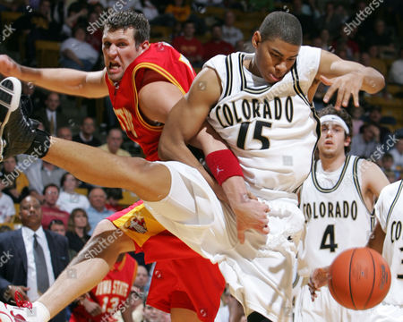HOMAN COPELAND Iowa State center Jared Homan, left, and Colorado forward Chris Copeland try to get possession of the ball under the basket during the second half of Iowa State's 78-73 victory in the teams' Big-12 Conference regular-season finale in Boulder, Colo