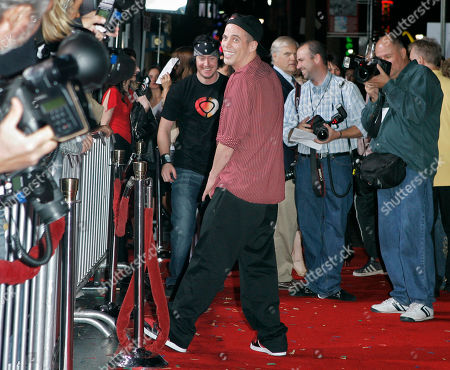 """Steve-O, Ehren McGehehey Steve-O urinates on the red carpet as Ehren McGhehey, left, watches at the premiere of """"Jackass Number Two,"""" Thursday night, in the Hollywood area of Los Angeles"""