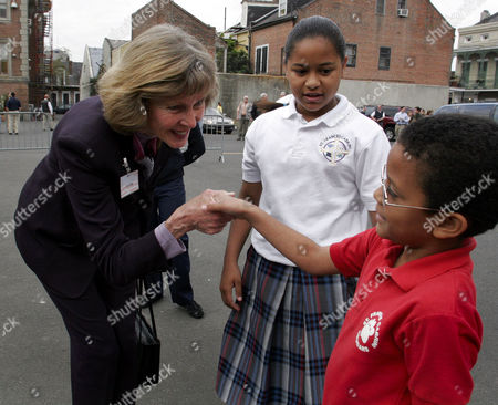 CAPPS LUKE Congresswoman Lois Capps, D-Calif, left shakes hands with Jude Luke, 7, as his sister Jade, 11, center, looks on at the Cathedral Academy in the French Quarter of New Orleans on . Members of Congress are on a three-day tour of the three-state region hit hard by Hurricane Katrina