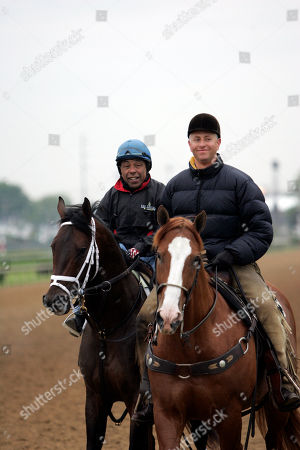 Kentucky Derby hopeful Coin Silver, with former jockey Angel Cordero Jr. up, is lead off the track by trainer Todd Pletcher at Churchill Downs, in Louisville, Ky