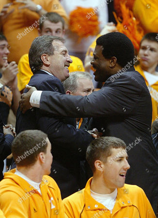 Bernard King, Ernie Grundfeld Former Tennessee basketball players Bernard King, right, and Ernie Grundfeld greet each other during the Tennessee-Kentucky game in Knoxville, TN. Grunfeld, director of basketball operations for the Washington Wizards was on-hand for a ceremony to retire King's #53 jersey