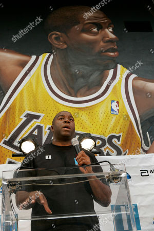 """Earvin Magic Johnson In This Dec. 1, 2006, former basketball star Earvin """"Magic"""" Johnson speaks during a news conference on World AIDS Day in Los Angeles. The Los Angeles Lakers announced, taht Johnson has sold his small ownership stake in the Lakers to Dr. Patrick Soon-Shiong"""