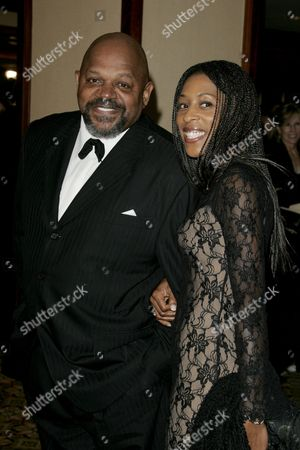 Charles S. Dutton and wife