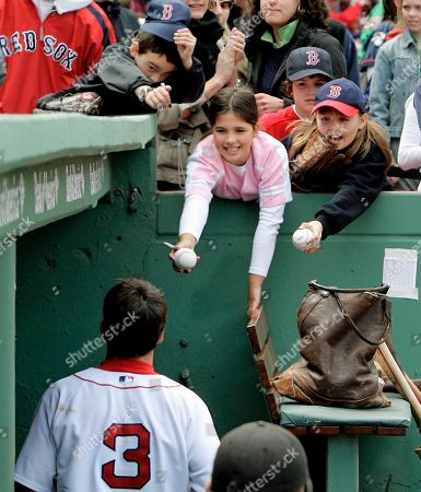 Mark Loretta Young Boston Red Sox fans hang over the dugout wall looking for an autograph from second baseman Mark Loretta after he hit a two-run homerun against the Seattle Mariners during their American League baseball game at Fenway Park in Boston . The Red Sox defeated the Mariners 7-6