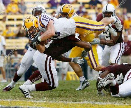 Stock Image of Louisiana State running back Jacob Hester (18) goes over Mississippi State defensive back Keith Fitzhugh (1) for a touchdown in the second half of their football game in Baton Rouge, La., . LSU won 48-17