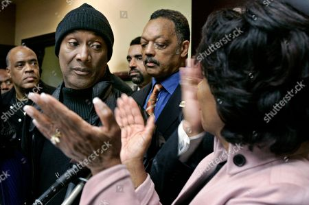 Maxine Waters, Jesse Jackson, Paul Moody In this file picture, U.S. Rep. Maxine Waters, D-Los Angeles, right, with Rev. Jesse Jackson, second from right, applauds comedian Paul Mooney, second from left, who agreed to stop using the N-word in his act during a news conference in Los Angeles. His announcement was in response to comedian Michael Richards' tirade at a Los Angeles comedy club. The N-word is no ordinary one. It is the essence of black pain, yet many African-Americans use it with pride, like a hard-won privilege. The epithet is undeniably racist and there have been widespread efforts to eliminate it from the black vernacular, yet it refuses to die