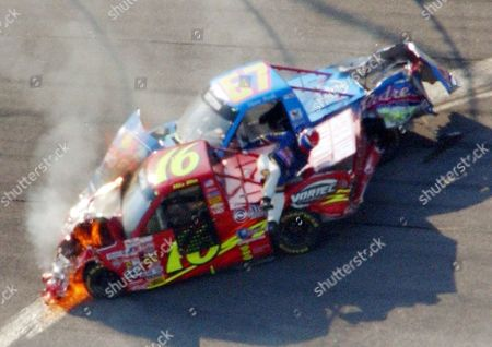 NASCAR ATLANTA Steve Park, in the No. 67 South Padre Island Toyota, climbs over the No. 16 Chevy Trucks Chevrolet of Mike Bliss to get away from the wreck as both vehicles burn during running of the EasyCare Vehicle Service Contracts 200 at Atlanta Motor Speedway in Hampton, Ga