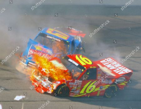 NASCAR ATLANTA Mike Bliss, in the No. 16 Chevy Trucks Chevrolet, bursts into flame as it impacts Steve Park, in the No. 67 South Padre Island Toyota during running of the EasyCare Vehicle Service Contracts 200 at Atlanta Motor Speedway in Hampton, Ga