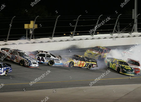 WOOD Mike Bliss (30), Justin Labonte (44), Randy LaJoie (34), Ashton Lewis Jr. (25), and Jon Wood (47) are among the drivers involved in a crash during the closing laps of the NASCAR Busch Series Winn-Dixie 250 at Daytona International Speedway in Daytona Beach, Fla