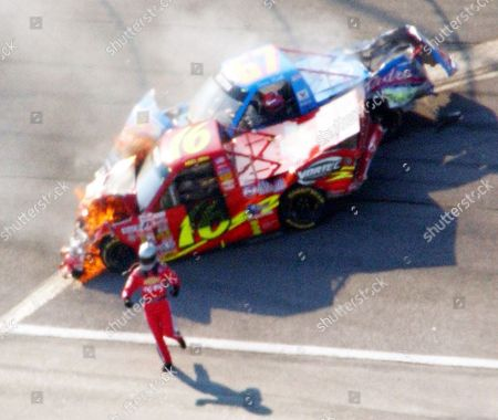 PARK BLISS Steve Park, in the No. 67, starts to climb out of his truck as Mike Bliss runs from his No. 16 truck as both vehicles burn during the running of the NASCAR Craftsman Trucks EasyCare Vehicle Service Contracts 200 at Atlanta Motor Speedway in Hampton, Ga., on