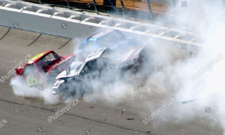 NASCAR ATLANTA NASCAR Craftsman trucks of Steve Park, right, Mike Bliss, left, and Eric Norris, top center, crash during running of the EasyCare Vehicle Service Contracts 200 at Atlanta Motor Speedway in Hampton, Ga