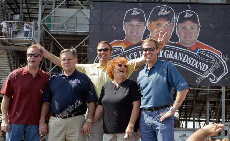 WALLACE Rusty Wallace, right, is seen with, left, to right, his brother Kenny Wallace, father Russ Wallace and mother Judy Wallace as brother Mike Wallace gives his two brothers rabbit ears during the Rusty Wallace Grandstand dedication ceremony at Gateway International Raceway, in Madison, Ill