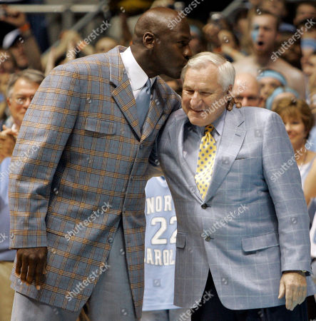 Michael Jordan, Dean Smith Shows former North Carolina player Michael Jordan, left, giving his former coach Dean Smith a kiss during halftime of a college basketball game between North Carolina and Wake Forest in Chapel Hill, N.C. ''It's a whole new world,'' said Steve Fisher, the 70-year-old San Diego State coach who made his name leading Michigan's Fab Five to the Final Four in the '90s. ''With Dean and Tark, and I'll throw my group in there, no one ever got into it thinking, 'I'm going to get rich being in this profession.' Today, a lot of people get rich as a result of being in this profession. Everything about that isn't totally healthy