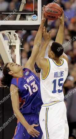 Joakim Noah, Ryan Hollins Florida's Joakim Noah, left, blocks the shot of UCLA's Ryan Hollins during the first half of their Final Four national championship basketball game in Indianapolis