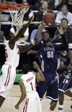 Roy Hibbert; Othello Hunter; Mike Conley Jr Georgetown's Roy Hibbert (55) attempts a basket as Othello Hunter, left, and Mike Conley, bottom, block during their Final Four semifinal basketball game at the Georgia Dome in Atlanta