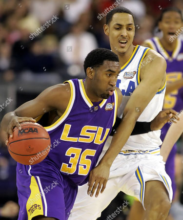 Ryan Hollins, Darnell Lazare LSU's Darnell Lazare, left, drives around UCLA's Ryan Hollins during their Final Four semifinal basketball game in Indianapolis