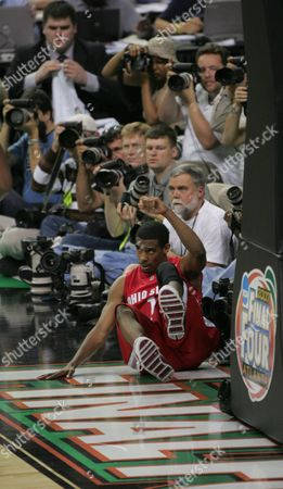 Mike Conley Jr Ohio State guard Mike Conley Jr. falls into photographers during the Final Four basketball championship game at Georgia Dome in Atlanta