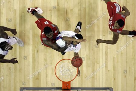 Greg Oden, Corey Brewer Ohio State center Greg Oden fouls Florida forward Corey Brewer under the basket in the Final Four basketball championship game at Georgia Dome in Atlanta