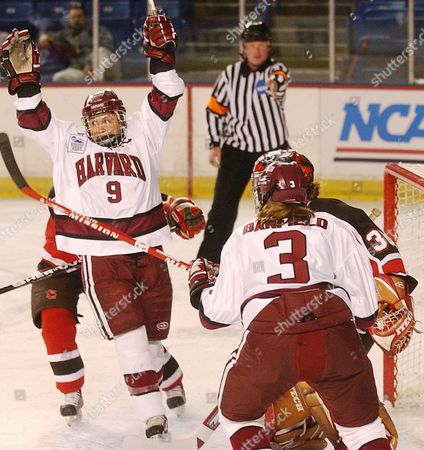 CORRIERO BANFIELD Harvard's Nicole Corriero (9) cheers with Ashley Banfield after her first-period goal against St. Lawrence during a semifinal of the women's Frozen Four at the Whittemore Center in Durham, N.H., . The goal put Harvard ahead for good in a 4-1 win