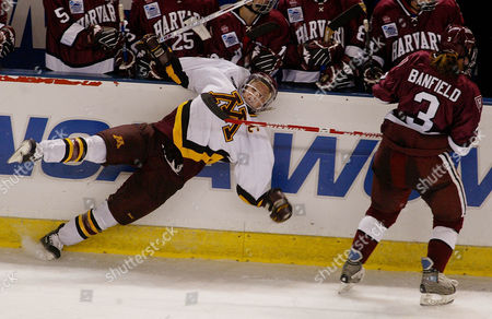 BANFIELD WENDELL Harvard's Ashley Banfield, right, takes down Minnesota's Krissy Wendell in the third period during the NCAA Women's Frozen Four championship, in Durham, N.H. Minnesota won 4-3