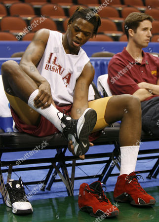 GARY SPRINGER Iona's Gary Springer changes shoes during practice for the NCAA basketball tournament, in Jacksonville, Fla. Iona will face Louisiana State in the first round of the tournament Thursday