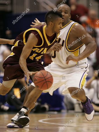 SOLIVER Iona's Ricky Soliver (14) drives past Louisiana State's Glen Davis in the second half of a first-round NCAA tournament basketball game, in Jacksonville, Fla