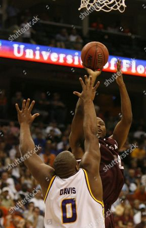DAVIS Texas A&M's Joseph Jones, right, takes a shot over Louisiana State's Glen Davis in the first half of a second-round NCAA basketball tournament game, in Jacksonville, Fla