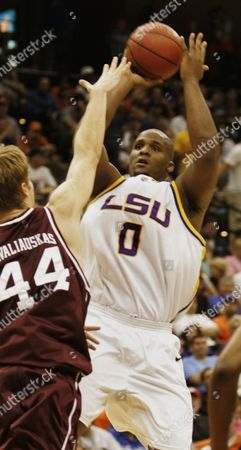 KAVALIAUSKAS Louisiana State's Glen Davis (0) takes a shot over Texas A&M's Antanas Kavaliauskas in the first half of a second-round NCAA basketball tournament game, in Jacksonville, Fla
