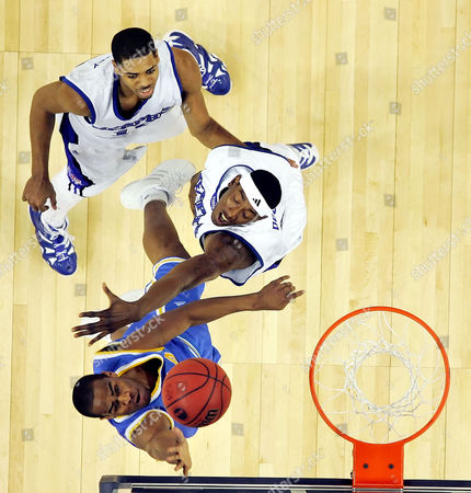 CARNEY UCLA'S Arron Afflalo, bottom left, shoots past Memphis' Robert Dozier, middle, and Rodney Carney, top, left, during the NCAA Tournament regional final college basketball game, in Oakland, Calif. UCLA beat Memphis, 50-45, to advance to the Final Four