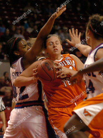SMITH GIBSON JOHNSON Virginia Tech's Erin Gibson drives to the basket as DePaul's Khara Smith, left, and Erin Carney defend during the first half of their NCAA tournament first-round game, inj\ College Park, Md