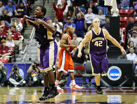 Stock Photo of SMITH Washington's Joel Smith, left, celebrates along with teammte Mike Jensen, right, while Illinois' Rich McBride walks away after defeating Illinois in a second-round game in the NCAA college basketball tournament, in San Diego. Washington won 67-64
