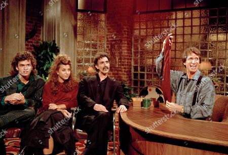"""Brenner Zappa Comedian David Brenner hosts avant garde fusion musician Frank Zappa, center, and his children, Dweezil, left, and Moon Unit, during a taping of Brenner's """"Nightlife"""" talk show in New York. Brenner holds a necktie given to Frank Zappa upon entering a restaurant earlier in the day. On, publicist Jeff Abraham announced Brenner has died at the age of 78"""